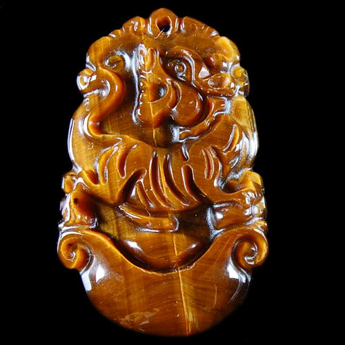 Pendant Oeil de Tigre signe Tigre 34x21x6mm La Piece Photo Confo